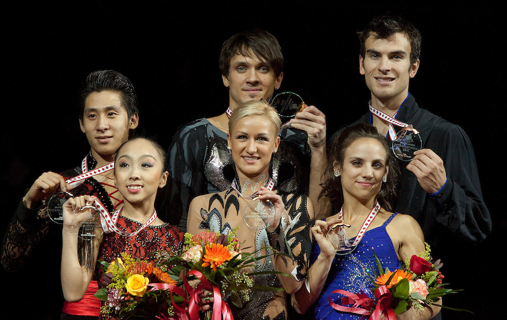-20111029- Mississauga, Ontario,Canada-  Gold medalists in the pairs competition Tatiana Volosozhar and Maxim Trankov of Russia, centre, Silver medalists Wenjing Sui and Cong Han of China, left, and bronze medalists Paige Lawrence and Rudi Swiegers of the Canada pose with their medals at Skate Canada International, in Mississauga, Ontario, October 29, 2011.<br /> AFP PHOTO/Geoff Robins
