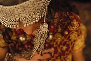 """Shy"" by Amira Al Sharif.  Girl in Yemen wearing traditional clothing with silver."