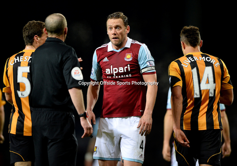 26 March 2014 - Barclays Premier League - West Ham United v Hull City - Referee, Mike Dean speaks with Kevin Nolan of West Ham United - Photo: Marc Atkins / Offside.
