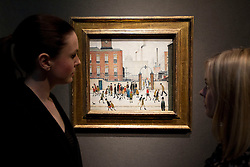 © Licensed to London News Pictures. 10/12/2012. London, UK. Two Christie's employees view 'At the Mill Gate' (1945) (est. GB£1,200,000-1,800,000) by Laurence Stephen Lowry at a press view held at the auction house's King Street Premises in London today (10/12/12). The evening auction, entitled 'Rule Britannia', and featuring over 185 lots by Britain's most influential modern artists, takes place on Wednesday the 13th Of December. Photo credit: Matt Cetti-Roberts/LNP