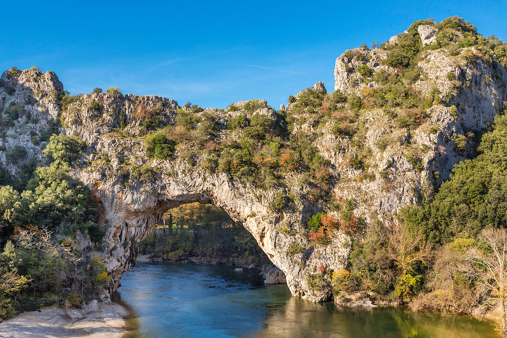 The natural landmark Pont d´Arc at the Gorges de l'Ardeche in Vallon (France). A famous sightseeing and sports destination for kayaking and swimming.