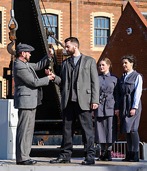Written and directed by National Theatre of Scotland Associate Director, Simon Sharkey, the Shift  finale at Summerlee Museum is a large-scale, outdoor, multi-media theatrical event featuring  striking video and lighting design and original music and words from punters, poets, playwrights and pen-smiths from across North Lanarkshire. Shiftl tells the stories of the many 'shifts' put in by the workers who built the world and created our future. The show runs at Summerlee Museum in Coatbridge from 29 March to 1 April 2018.<br /> <br /> Professional cast L to R:  Stephen Clyde,  Daniel Cahill, Katie Barnett and  Fletcher Mathers<br /> <br /> (c) Andrew Wilson | Edinburgh Elite media