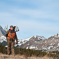 Mule deer hunter backpacking big trophy antlers