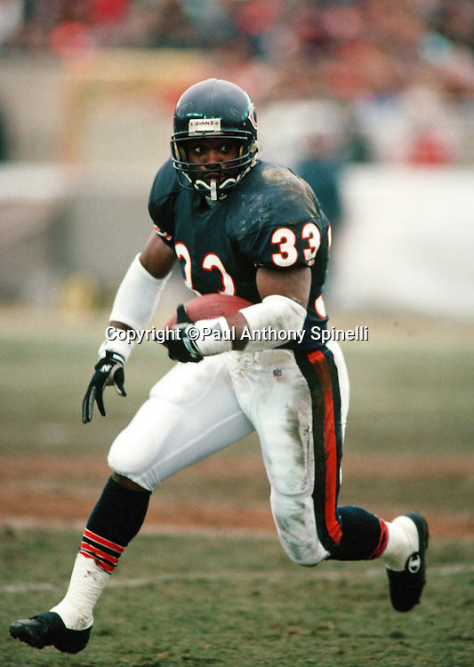 Chicago Bears running back Darren Lewis (33) runs the ball during the NFL NFC Wild Card playoff football game against the Dallas Cowboys on Dec. 29, 1991 in Chicago. The Cowboys won the game 17-13. (©Paul Anthony Spinelli)