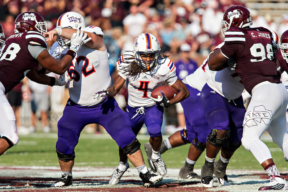STARKVILLE, MS - SEPTEMBER 19:  Daniel Taylor #4 of the Northwestern State Demons runs the ball through the line during a game against the Mississippi State Bulldogs at Davis Wade Stadium on September 19, 2015 in Starkville, Mississippi.  The Bulldogs defeated the Demons 62-13.  (Photo by Wesley Hitt/Getty Images) *** Local Caption *** Daniel Taylor
