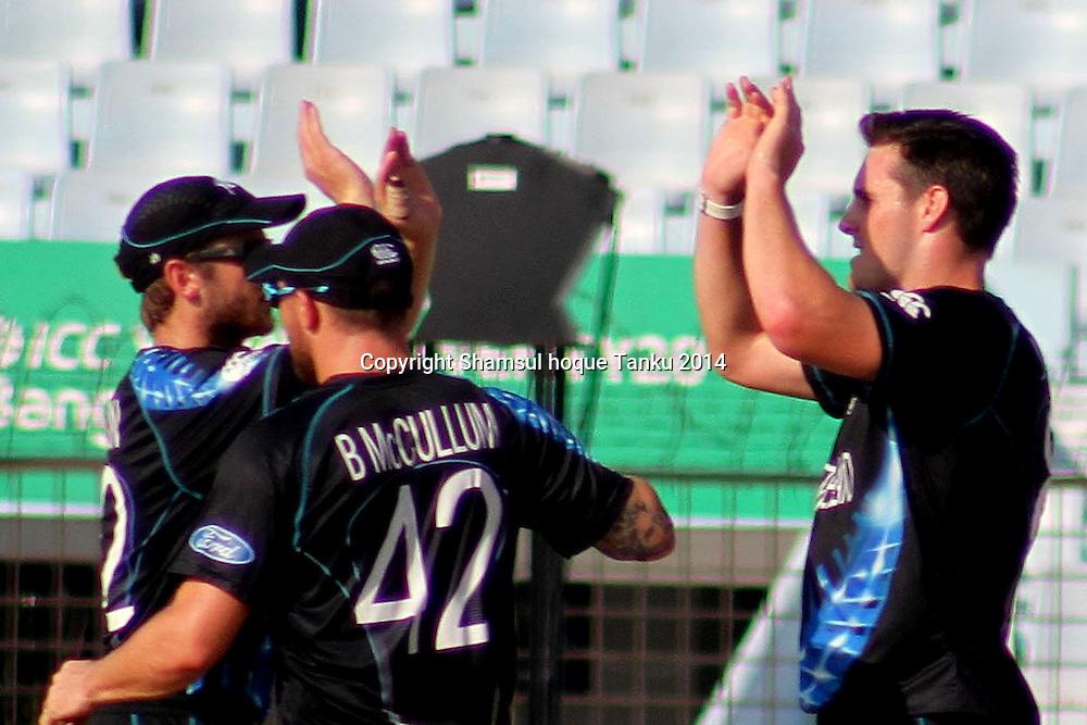 Mitchell McClenaghan celebrates with team - New Zealand Black Caps v Netherlands, Zahur Ahmed Chowdhury Stadium, Chittagong, Bangladesh. ICC World Twenty20 cricket Bangaldesh 2014. 29 March 2014. Photo: Shamsul hoque Tanku/www.photosport.co.nz