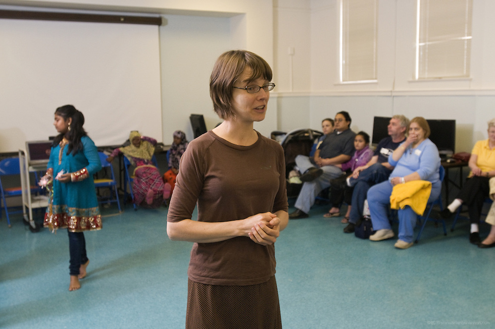 Immigrant services librarian Sophie Maier introduces dancer Vindhya Katta, instructor of Nachale: The Bollywood Dance Workout, during the English Conversation Club: Dance and Dialogue event Saturday April 9, 2011 at the Iroquois Branch of the Louisville Free Public Library in Louisville, Ky. Henna and Bindi followed the Bollywood dance lesson, and then volunteers were paired with English language learners to work on conversation skills. (Photo by Brian Bohannon)