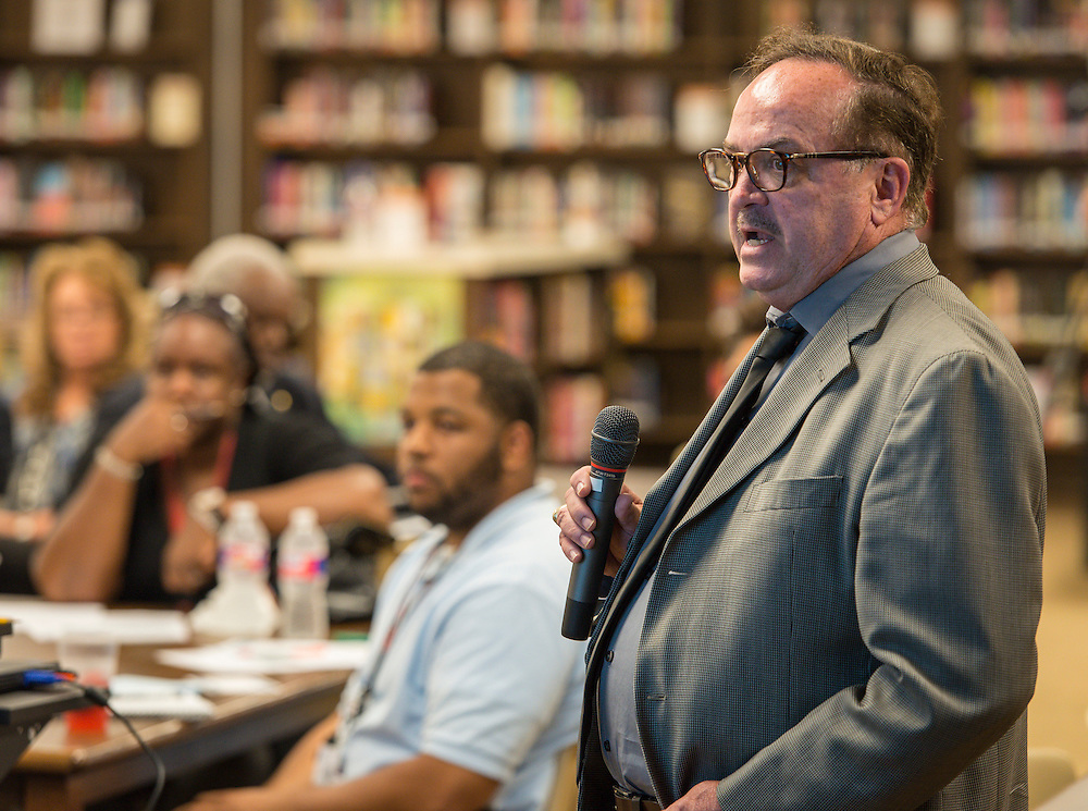Houston ISD staff and Randall-Porterfield Architects discuss renovation for Scarborough High School during a community meeting, September 24, 2015.