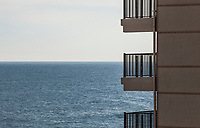 Balconies on a building in Ocean City, Maryland and the Atlantic Ocean in the background, USA.
