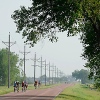 Riders make their way between Howard and Canova on Tuesday morning during the third day of the Tour de Kota.
