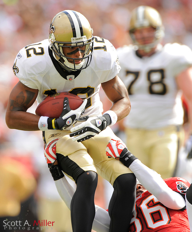 Nov. 22, 2009; Tampa, FL, USA; New Orleans Saints wide receiver Marques Colston (12) is tackled by Tampa Bay Buccaneers safety Tanard Jackson (36) during their game at Raymond James Stadium. ©2009 Scott A. Miller.© 2009 Scott A. Miller
