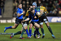 Gordon D'Arcy (Leinster) takes on the Northampton defence - Photo mandatory by-line: Patrick Khachfe/JMP - Tel: Mobile: 07966 386802 07/12/2013 - SPORT - RUGBY UNION -  Franklin's Gardens, Northampton - Northampton Saints v Leinster - Heineken Cup.