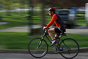 A participant bikes during the O'Bleness Race for a Reason Triathlon Saturday, April 27, 2013. The triathlon included a 500mm Serpentine Swim at the Ohio University Aquatic Center, a 15 mile bike ride to the Plains and back and then a 5k run that finished at Tailgreat Park across from Peden Stadium. Race for a Reason, Race 4 A Reason, Annual Events, Events, Students, Faculty & Staff