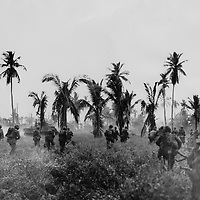 Medium Sherman tanks lead the way as Marines break through a clearing in the thick brush on Guam in pursuit of the retreating Japanese.