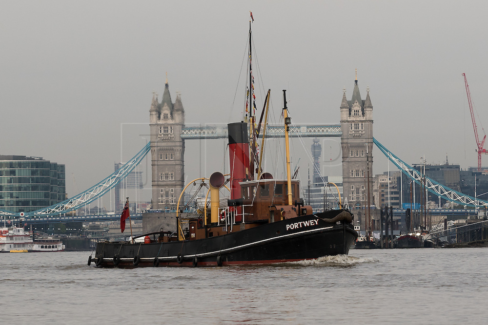 © Licensed to London News Pictures. 19/09/2016. LONDON, UK.  The historic Steam Tug, Portwey making her final journey this autumn on the River Thames near Tower Bridge during sunny weather this morning. Steam Tug Portwey is returning to her mooring in West India Dock, where she will remain during the winter months to have her engine stripped down and maintenance work carried out. Steam Tug Portwey is the only twin screw, coal fired steam tug still active in the United Kingdom.  Photo credit: Vickie Flores/LNP