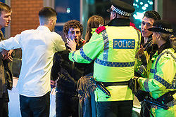 "© Licensed to London News Pictures . 23/12/2017. Manchester, UK. Police intervene to break up a fight outside the Printworks . Revellers out in Manchester City Centre overnight during "" Mad Friday "" , named for being one of the busiest nights of the year for the emergency services in the UK . Photo credit: Joel Goodman/LNP"