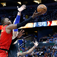 25 February 2017: Atlanta Hawks forward Paul Millsap (4) goes for the layup against Orlando Magic center Nikola Vucevic (9) during the Orlando Magic 105-86 victory over the Atlanta Hawks, at the Amway Center, Orlando, Florida, USA.