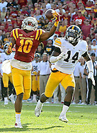 Iowa State Cyclones wide receiver Jauan Wesley (10) pulls in a touchdown between Iowa Hawkeyes defensive back Miles Taylor (19) and defensive back Desmond King (14) during the second quarter of their Iowa Corn Cy-Hawk Series NCAA football game at Jack Trice Stadium in Ames on Saturday, Sept. 12, 2015.