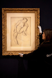 © Licensed to London News Pictures. 31/01/2013. London, UK. A Bonham's employee adjusts 'Femme nue assise' (c.1896) (est. GB£60,000-80,000) a drawing by French artist Edgar Degas at the press view for the Bonhams' Impressionist and Modern Art Sale in London today (31/01/13). The sale, to be held at the London based auction houses New Oxford Street premises on the 5th of February, features a selection of eclectic artists including Camille Pissarro, Fernand Leger and Edgar Degas. Photo credit: Matt Cetti-Roberts/LNP