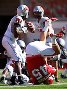Utah linebacker Boo Anderson (45) gets upended as UNLV quarterback Omar Clayton (2) looks for an open receiver during the third quarter of an NCAA college football game at Rice-Eccles Stadium, Saturday, Sept. 11, 2010, in Salt Lake City, Utah.  Utah defeated UNLV 38-10. (AP Photo/Colin E. Braley)