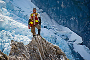 A geology student on a traverse in northern British Columbia