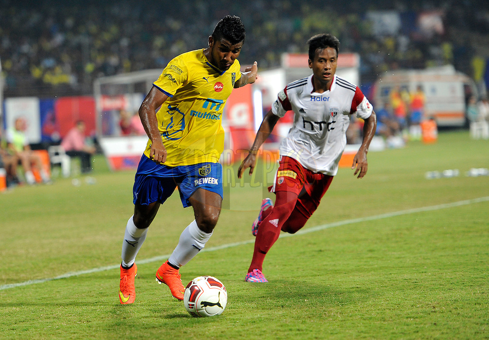 Nirmal Chettri of Kerala Blasters FC and Durga Boro of NorthEast United FC during match 49 of the Hero Indian Super League between Kerala Blasters FC and North East United FC held at the Jawaharlal Nehru Stadium, Kochi, India on the 30th November.<br /> <br /> Photo by:  Pal Pillai/ ISL/ SPORTZPICS