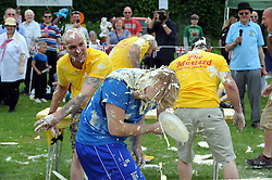 © Licensed to London News Pictures. 31/05/2014<br /> Luke Baker from team Baker Boys getting covered (blue)<br /> World Custard Pie Championships at Coxheath Heath Village,Coxheath,Kent.<br /> Photo credit :Grant Falvey/LNP