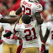 San Francisco 49ers running back Frank Gore (21) lifts San Francisco 49ers running back Kendall Hunter (32) during an NFL football game between the San Francisco 49ers  and the Tampa Bay Buccaneers on Sunday, December 15, 2013 at Raymond James Stadium in Tampa, Florida.. (Photo/Alex Menendez)