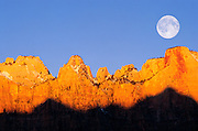 Full moon and winter dawn on the Towers of the Virgin, Zion National Park, Utah USA