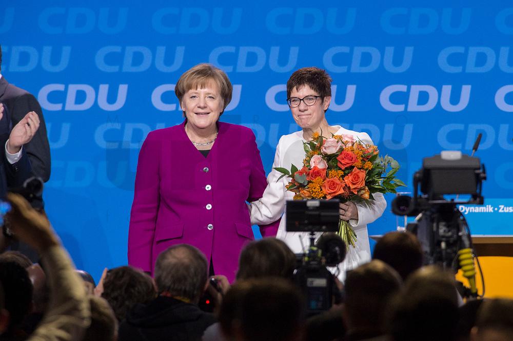 26 FEB 2018, BERLIN/GERMANY:<br /> Angela Merkel (L), CDU, Bundeskanzlerin, und Annegret Kramp-Karrenbauer (R), CDU Generalsekretaerin, nach der Wahl, CDU Bundesparteitag, Station Berlin<br /> IMAGE: 20180226-01-166<br /> KEYWORDS: Party Congress, Parteitag, Blumen, flowers, Jubel, Applaus, klatschen, applaudieren