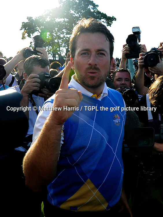 Graeme MCDOWELL (EUR) celebrates making the winning point for Europe beating Hunter MAHAN (USA) 3 and 1 at the 17th,Europe win by 14.5 to 13.5 points during Session_Four_Singles, Ryder Cup Matches,Celtic Manor Twenty Ten Course,Newport,Gwent,Wales.