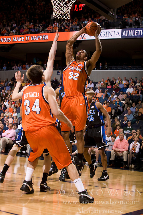 Virginia forward Mike Scott (32) goes up for a layup against Duke.  The Virginia Cavaliers men's basketball team fell to the #6 Duke Blue Devils 86-70 at the University of Virginia's John Paul Jones Arena in Charlottesville, VA on March 5, 2008.