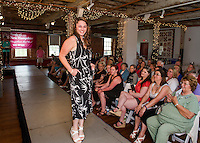 Jennifer Anderson of Laconia Motorcycle Week Association shows her softer side dressed in a casual summer outfit from Banana Republic during the Belknap Mill Fashion Show on Sunday afternoon.  (Karen Bobotas/for the Laconia Daily Sun)
