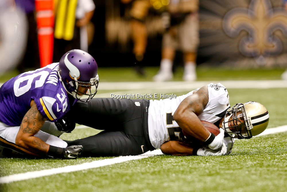 Sep 21, 2014; New Orleans, LA, USA; New Orleans Saints wide receiver Marques Colston (12) scores a touchdown past Minnesota Vikings strong safety Robert Blanton (36) during the second half of a game at Mercedes-Benz Superdome. The Saints defeated the Vikings 20-9. Mandatory Credit: Derick E. Hingle-USA TODAY Sports