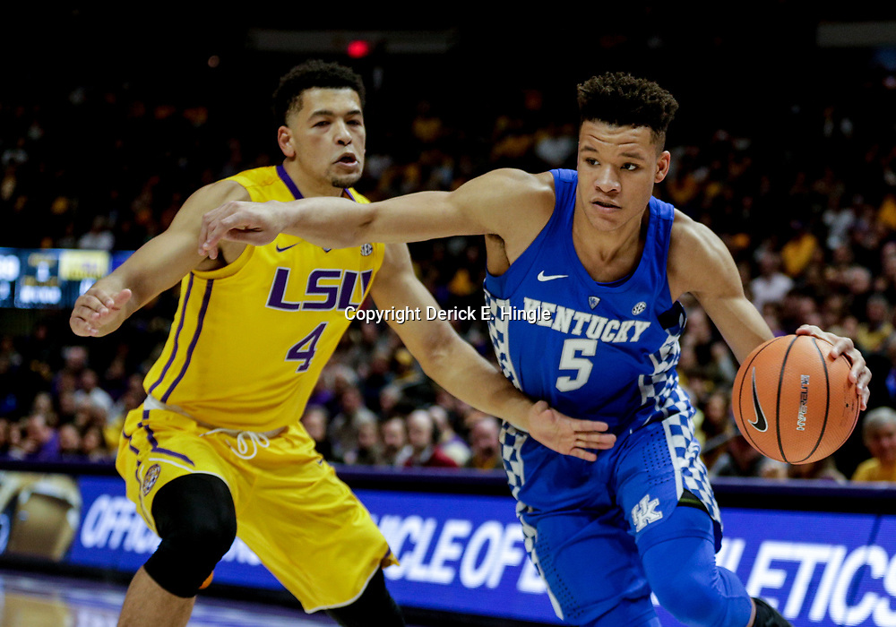 Jan 3, 2018; Baton Rouge, LA, USA; Kentucky Wildcats forward Kevin Knox (5) drives past LSU Tigers guard Skylar Mays (4) during the first half at the Pete Maravich Assembly Center. Mandatory Credit: Derick E. Hingle-USA TODAY Sports
