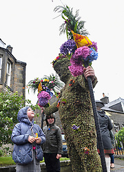 Pictured: Burryman Andrew Taylor meets 6 year old Maggie Pennington from Queensferry on his tour.<br /> <br /> The folklore character the Burryman carried out his annual walk through the streets of Queensferry to mark the start of the Ferry Fair, traditionally having a glass of whisky at every bar on the route. Covered head to toe in over 20,000 burrs, the tradition dates back hundreds of years.<br /> <br /> © Dave Johnston / EEm