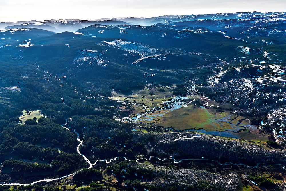 Aerial view of the headwaters of the Snake River in Yellowstone National Park in springtime with many littel streams combining in high elevations