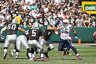 OAKLAND, CA - OCTOBER 10: Shawne Merriman #56 of the San Diego Chargers closes in on Bruce Gradkowski #5 of the Oakland Raiders at Oakland-Alameda County Coliseum on October 10, 2010 in Oakland, California. (Photo by Tom Hauck) Player:Shawne Merriman; Bruce Gradkowski