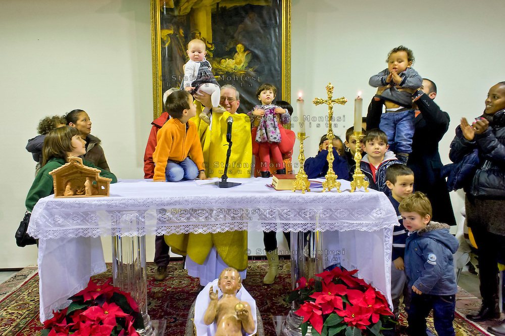 Roma 24  Dicembre 2014<br /> Messa di Natale con i poveri allla Cittadella della carit&agrave; Santa Giacinta ( Via Casilina Vecchia, 19),con gli ospiti, i volontari e gli operatori Caritas. Mons. Enrico Feroci, direttore della Caritas diocesana di Roma.