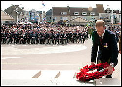 Image ©Licensed to i-Images Picture Agency. 06/06/2014. Arromanches, France. The Duke of Cambridge lays a wreath as The Duke and Duchess of Cambridge attend a Commemoration of the 70th anniversary of the Normandy Landings at Gold Beach, Normandy, France,  on the 70th anniversary of D-Day.  Picture by Andrew Parsons / i-Images