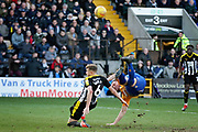 This attempt is cleared by Notts County defender Ben Barclay (6) during the EFL Sky Bet League 2 match between Notts County and Mansfield Town at Meadow Lane, Nottingham, England on 16 February 2019.