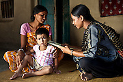 A female health worker makes a home visit to check on the progress of a mother and her daughter at the CINI Diamond Harbour Centre, near Kolkata, India. .Child In Need Institute (CINI) is a non-government organisation based in Kolkata, India.