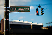 SHOT 10/13/09 3:04:07 PM - Steelawanna Ave. sign in Lackawanna, NY. Lackawanna is a city in Erie County, New York, U.S., located just south of the city of Buffalo in the western part of New York state. Lackawanna was a center of steel manufacture throughout most of the 20th century. In 1899 all the land along the West Seneca shore of Lake Erie was purchased by the Lackawanna Steel Company. Construction was started in 1900 and the plant began operation in 1903. The Lackawanna Steel Company was acquired by the Bethlehem Steel Company in 1922. With the 20th century growth of the Bethlehem Steel plant, at one time the fourth largest in the world, came the continued growth of the city and its institutions. At its peak the plant employed 20,000 people. It attracted people from many lands to settle here and make their homes. However, the latter half of the 20th century saw the decline of the steel plant and finally its closure. Buffalo, N.Y. is the second most populous city in the state of New York and is located in Western New York on the eastern shores of Lake Erie and at the head of the Niagara River. By 1900, Buffalo was the 8th largest city in the country, and went on to become a major railroad hub, the largest grain-milling center in the country and the home of the largest steel-making operation in the world. The latter part of the 20th Century saw a reversal of fortunes: by the year 1990 the city had fallen back below its 1900 population levels. (Photo by Marc Piscotty / © 2009)