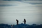 Children play on snowbanks near the Muskrat Jamboree's river site.