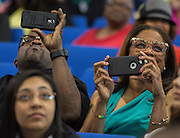 Family members watch the processional during the first ever graduation for Mickey Leland College Preparatory Academy, May 27, 2015.