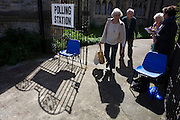 Two tellers log the election numbers and addresses of voters as they exit Christchurch United Reform Church, East Dulwich that serves as a temporary Polling station for voters on Britain's general election day. Their job is to record the election numbers of those about to vote, making surte that her political colleagues don't drop more literature in to that address, now that the occupants have voted. There is normally three tellers from each of the main parties but here, only Labour and Lib Dem volunteers were present.