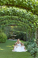 Bride and Flower Girls in Formal Garden