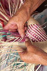 North America, Mexico, Oaxaca Province, Oaxaca, hands weaving straw baskets in market