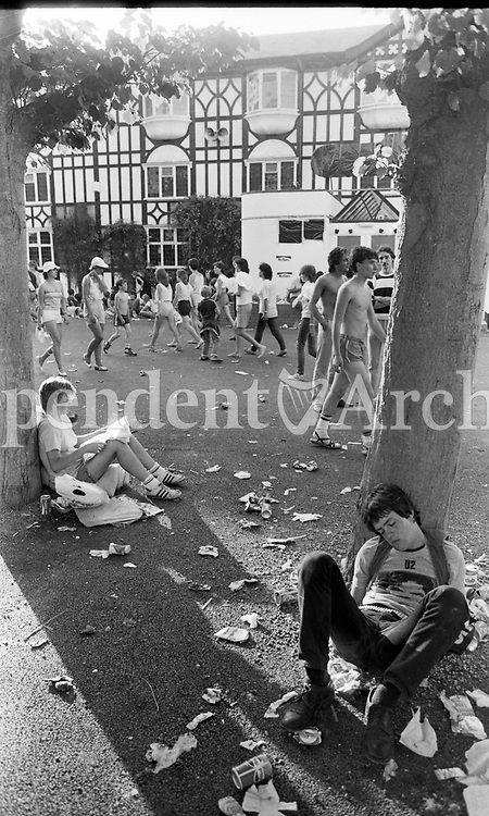 Slane concert 1983 held in the Phoenix Park that year.<br /> Fans enjoying themselves.<br /> (Part of the Independent Newspapers/NLI collection.)