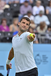 June 19, 2018 - London, England, United Kingdom - Bulgaria's Grigor Dimitrov serves against Bosnia and Herzegovina's Damir Dzumhur during their first round men's singles match at the ATP Queen's Club Championships tennis tournament in west London on June 19, 2018. Dimitrov won the match 6-3, 7-6, 6-3. (Credit Image: © Alberto Pezzali/NurPhoto via ZUMA Press)